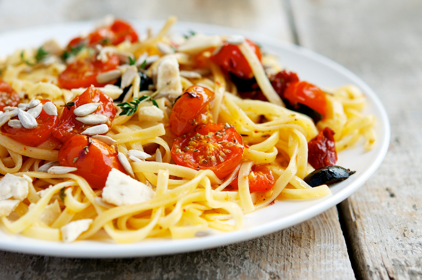 Pasta with roasted cherry tomatoes, black olives and vegan cheese. A lovely blend of flavors
