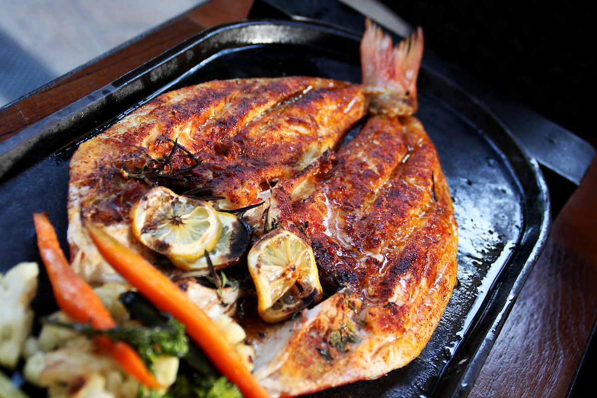 Flair metal 9 delicious dishes served in cast iron cookware for Pm fish steak house