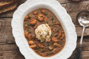 Seafood gumbo in a white bowl