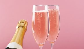 Two flutes of pink sparkling wine