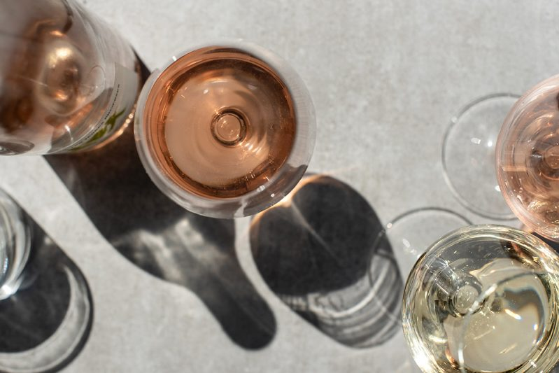 Wine glasses filled with white and rose wines