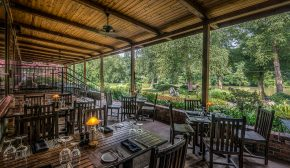 A restaurant patio that overlooks a river