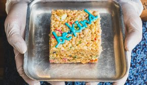 """A crispy rice cereal treat that says """"be kind"""" in frosting"""