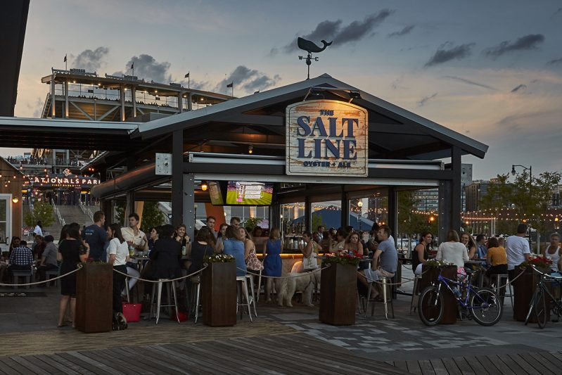 People dine outside at The Salt Line