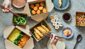 Sushi in takeout boxes