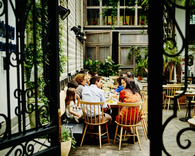 Diners eating on a patio