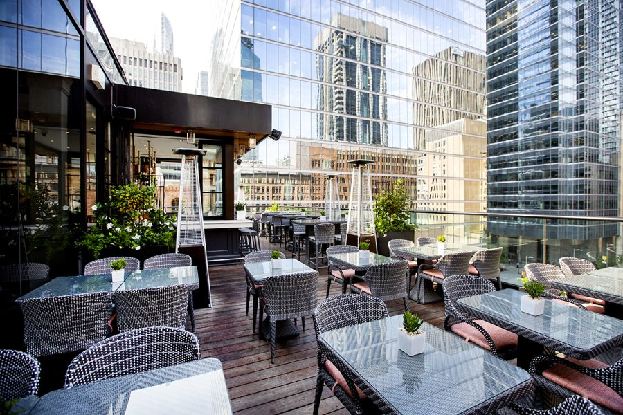 Rooftop seating with skyscrapers in the background