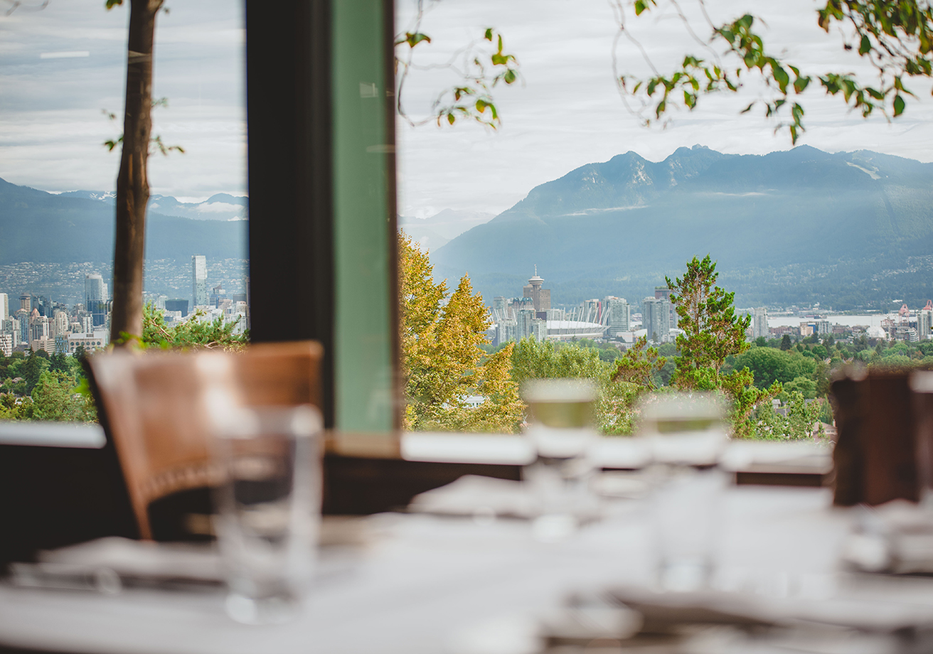 A table overlooks the Vancouver skyline