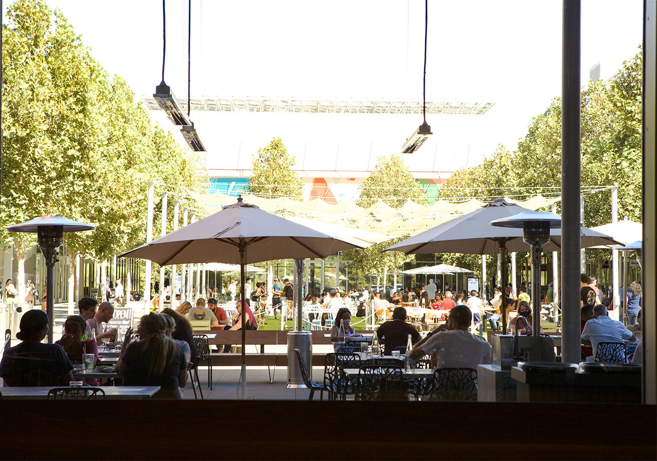 An outdoor patio with people dining.
