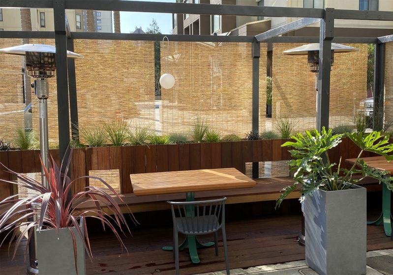 Outdoor tables with heaters