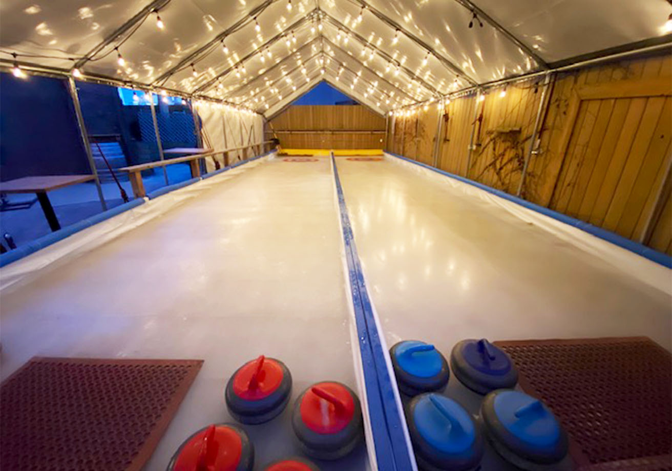 A curling rink under a tent.