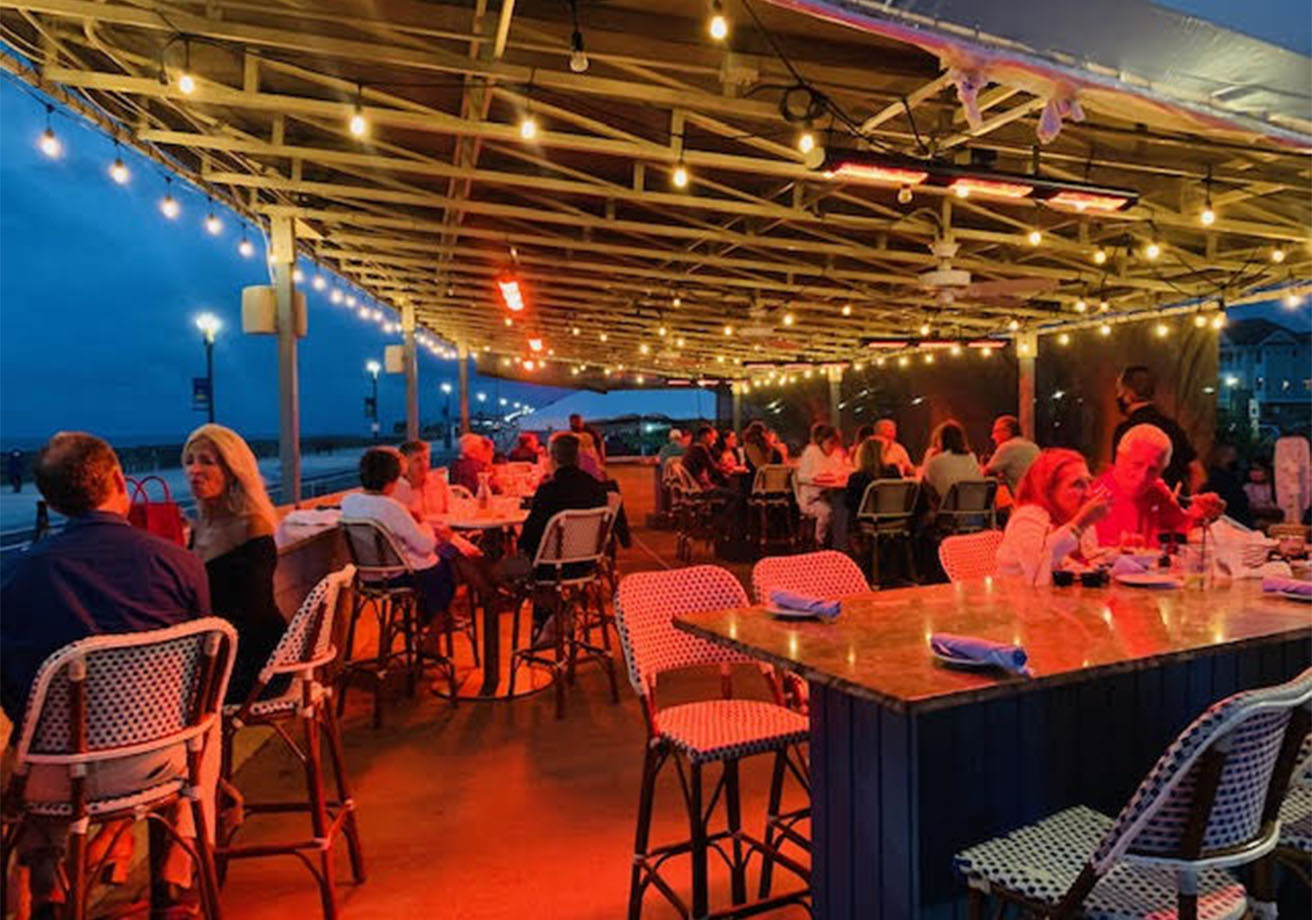 People dining on a covered patio.