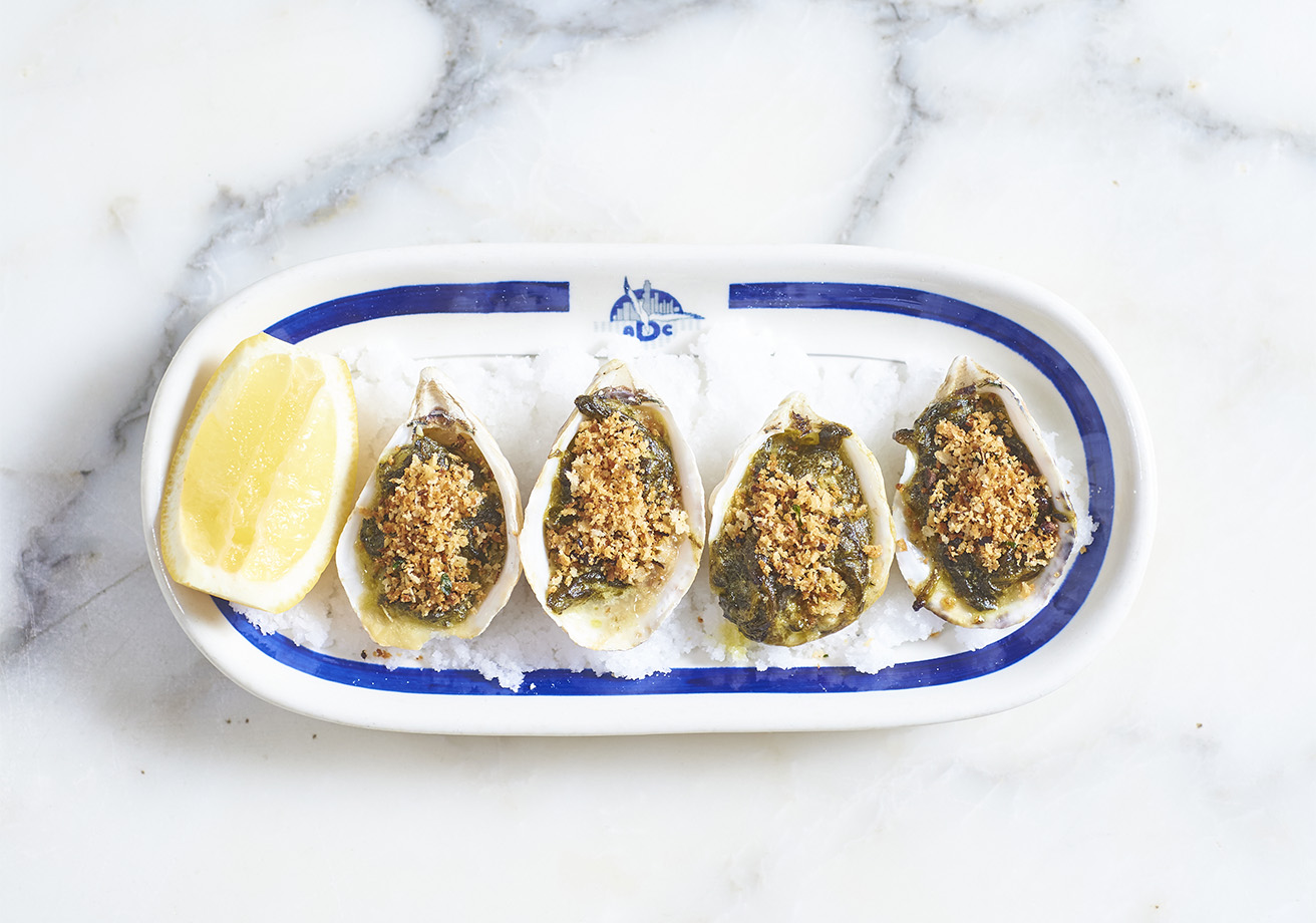A plate of grilled oysters.