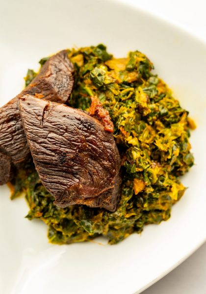 A plate of beef and greens.