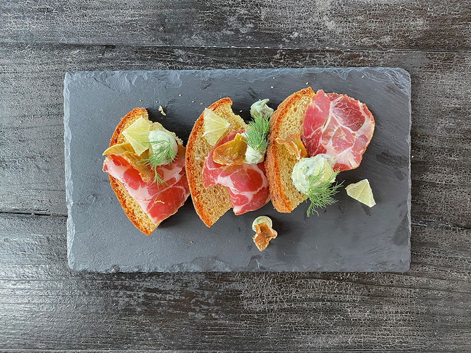 burrata cheese with blood orange fruit and prosciutto