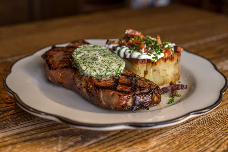 ny-strip-herb-butter-potato-pave-sour-cream-bacon-chive