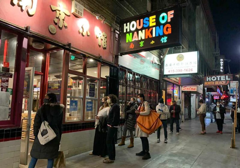 Diners outside House of Nanking restaurant