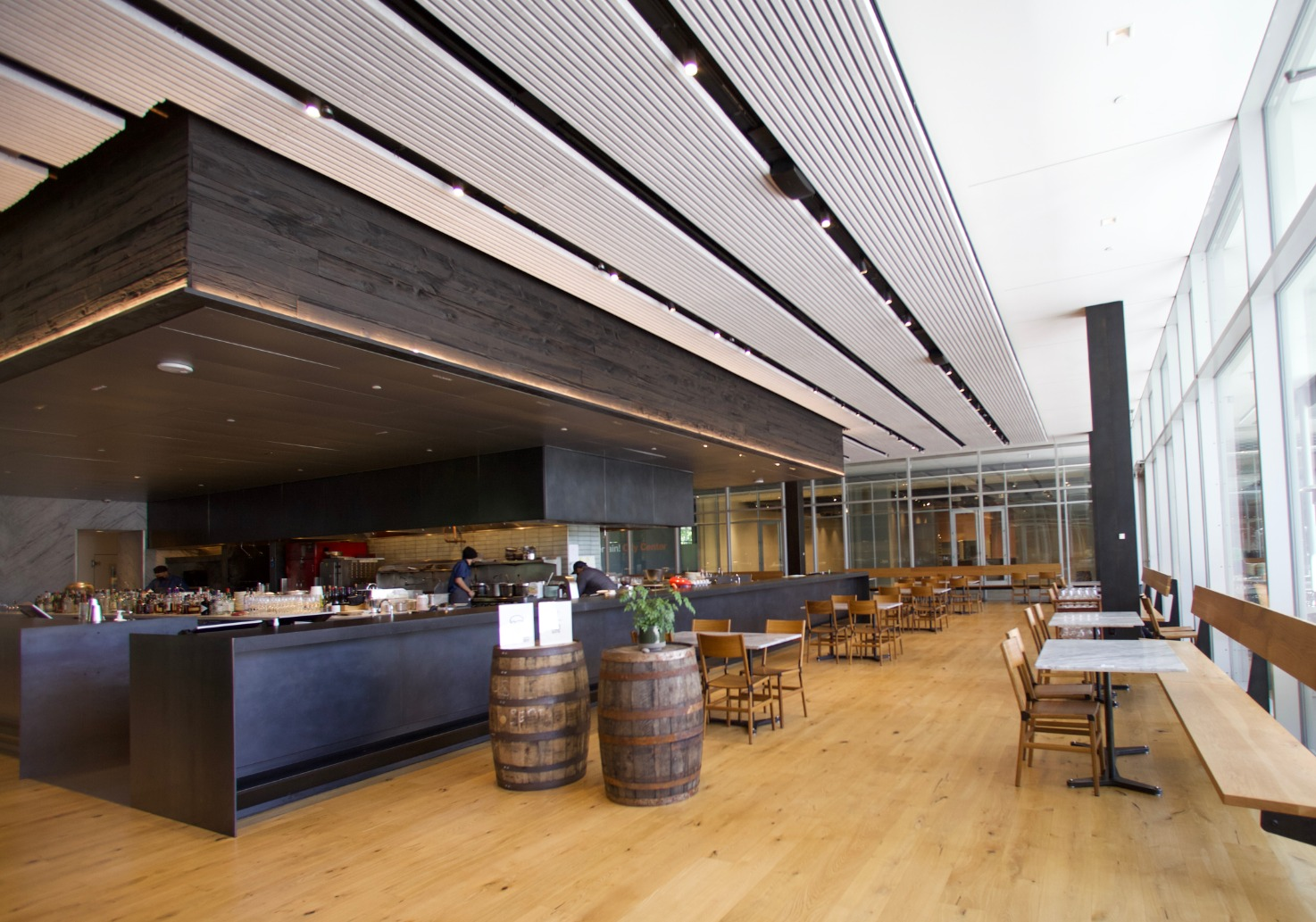 Dining room of The Slanted Door San Ramon with open kitchen