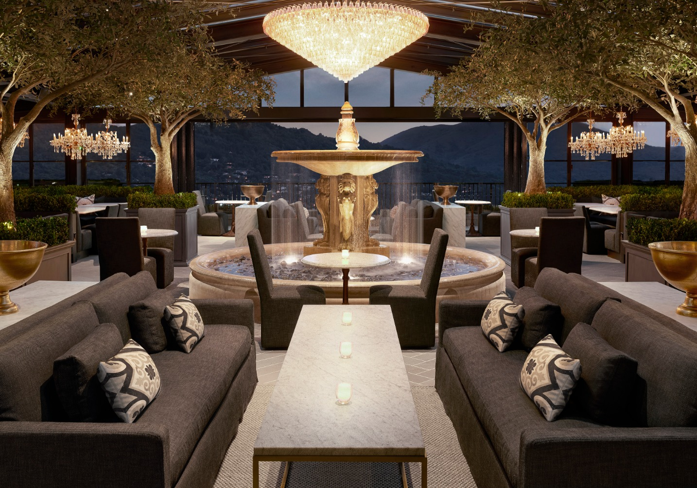 Dining room of RH Rooftop Restaurant with fountain and sofas